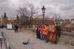 Concert on the Charles bridge at Praha. A group of musicians are showing beautiful songs on the Charles bridge in Prague, Czech Republic Royalty Free Stock Images