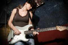 Concert at the club. Woman playing guitat at the club Royalty Free Stock Photo
