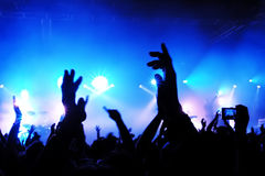 Concert Crowd. Cheering crowd at concert, bright red lights from stage Royalty Free Stock Images