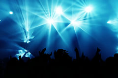 Concert Crowd. Cheering crowd at concert, bright red lights from stage Royalty Free Stock Photo
