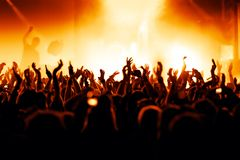 Concert Crowd. Cheering crowd at concert, bright yellow lights from stage Stock Photography