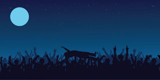 Concert crowd. Silhouettes of people in a crowd with a crowd surfer and a guy jumping Royalty Free Stock Photos
