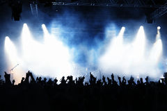 Concert Crowd. Cheering crowd at concert, musicians on the stage Royalty Free Stock Photo