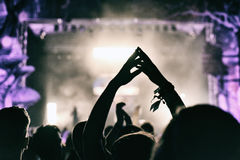 Concert crowd applauding. At a music festival Royalty Free Stock Photography