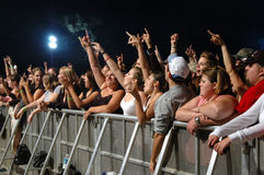 Concert crowd cheering behind barrier Royalty Free Stock Photos
