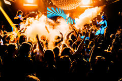 Concert crowd confetti dancing lights royalty free stock photography