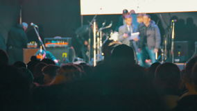Concert Crowd at Music Festival. KAMENSKOE CITY, UKRAINE - OCTOBER 15, 2016, Rock concert at the Square Peter Kalnyshevsky. Crowd people dancing Rock concert stock video footage