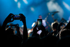 Concert crowd. Takes on a mobile phone Stock Image