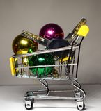 Concert of expensive gift, New Year`s deal. Trolley with balls and keys inside royalty free stock images