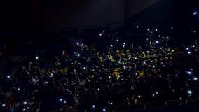 Concert fans turned on flashlights on smartphones