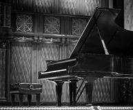Concert grand piano. On the stage in black and white royalty free stock photo