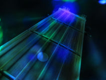 Concert Guitar. An abstract background of an acoustic guitar in green and blue concert lights Royalty Free Stock Photo