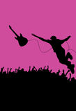 Concert guitarist. An illustration showing a silhouetted guitarist diving into the crowds from the concert stage as a performance stunt Royalty Free Stock Photo
