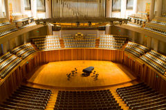 Concert hall. Modern concert hall with piano on the center stage Royalty Free Stock Images