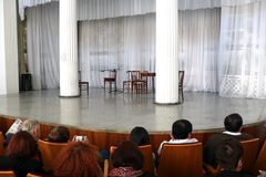Concert hall. Audience waiting for an ensemble to enter the stage royalty free stock photo
