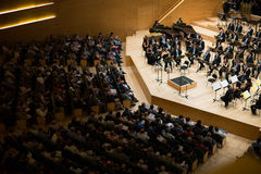 Concert hall Auditori Banda municipal de Barcelona with audience. BARCELONA, SPAIN - NOVEMBER 08, 2015: Audience and orchestra at the concert Carmina Burana in Stock Photography