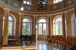 Concert hall. Black grand piano in concert hall in ancient manor Stock Images