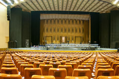 Concert hall scenery. Concert hall with lots of seats and a imposing stage Stock Images