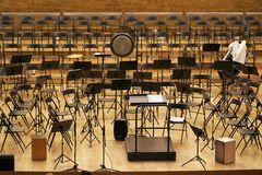 Concert hall stage with stands and chairs royalty free stock photos