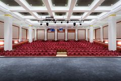 The interior of the hall in the theater. Concert hall of the theater with red new chairs. The interior of the hall in the theater  or cinema view from the stage Royalty Free Stock Photos