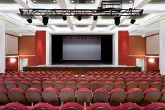 The interior of the hall in the theater. Concert hall of the theater with red new chairs. The interior of the hall in the theater or cinema  view of the stage Stock Images