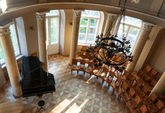 Concert hall top view. Black grand piano in concert hall in ancient manor, top view Royalty Free Stock Images