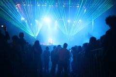 Concert lasers. Concert lights at night with people Royalty Free Stock Image