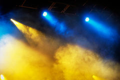 Concert light show. Image of colorful concert lighting on a dark background Stock Photos