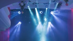 Concert lighting against a dark background ilustration. Spotlight on stage. Free stage with lights, lighting devices.  Stock Images