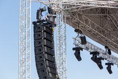 Concert lighting and sound. Setting up a stage lighting and sound equipment before the concert Stock Images