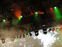 Concert lights. Detail of bright green and red concert lights Royalty Free Stock Photos