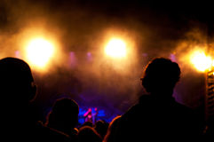 Concert lights. Crowd next to the colourful and warm concert lights Stock Image