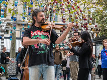 Concert master and first violin of a Paris street orchestra Royalty Free Stock Image