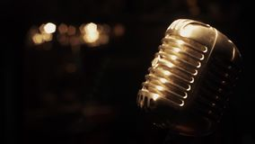 Concert metal vintage microphone stand on stage in empty retro club. Spotlights. stock video footage