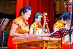 Orchestra of Chinese native music in red yellow colors stock images