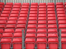 Concert Platform Closeup with Rows of Red Plastic Seats. Closeup on Concert Spectator Steel Platform with Rows of Red Plastic Seats Royalty Free Stock Photo