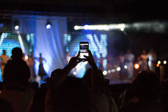 Concert recording. Smartphone Snapshot at a concert Stock Photo