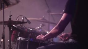 Concert rock band performing on stage. Drummer stock video footage