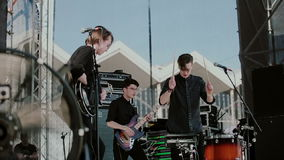 Concert rock band performing on stage with singer stock footage