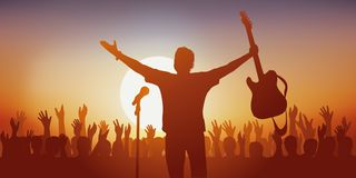 Symbol of the idol, with a rock singer greeting his fans royalty free stock photography