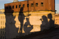 Concert on a roof. Shadows of people playing the guitar on the Petersburg's roof stock image