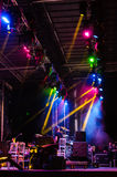 Concert Stage With Colorful Spotlights. Concert stage during final soundchecks with colorful spot lights and smoke during the summer performance art events Stock Photo