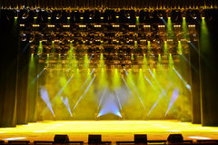 Concert stage. Illuminated empty concert stage with smoke and rays of light stock images