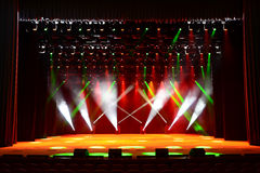 Concert stage. Illuminated empty concert stage with smoke and red and green beams Royalty Free Stock Photography
