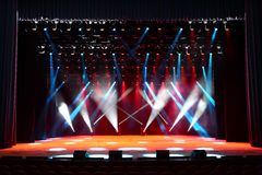 Concert stage. Illuminated empty concert stage with smoke and red, white and blue beams Stock Images