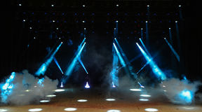 Concert stage. Illuminated empty theater stage with fog and rays of light Stock Photography