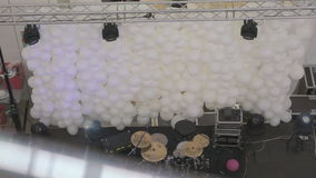 Concert stage with musical instruments. Nobody. Concert stage with musical instruments on a background of small white balls in the form of a wide wall. Nobody stock video