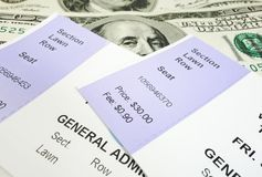 Concert tickets. Closeup of two concert tickets and cash Royalty Free Stock Image