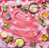Concert vegetarian food Red pepper garlic salt grated lemon herbs oil on red rustic wooden background  top view Royalty Free Stock Photography