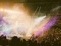 Concert vibe. Colourful lights in a concert full of people Stock Image